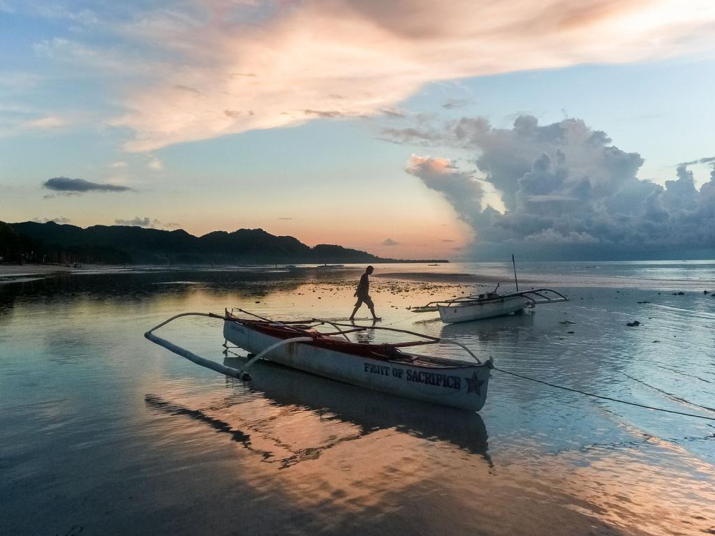 Fisherman-and-bankas-at-sunrise-Anda-beach-Bohol-Philippines