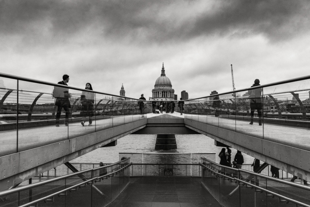 People-on-Millenium-bridge-with-St.Pauls-Cathedral-in-distance-London-England